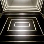 Partner: Urban Elevator Service, Inc. Materials: Black Powder Coated Steel, Stainless Steel #4 (satin), Inlaid Trim Design Elements: Art Deco