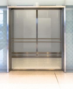 Custom oversized glass elevator cab at Mall of America, engineered and manufactured by G&R Custom Cabs in Minnesota. Translucent glass front entry doors.