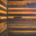 Elevator Interior Design modernization design engineered & manufactured by G&R Custom Elevtor Cabs: The bronze-edged lower elevator wall panels are made from repurposed leather belts of various size, color, wear, and texture.