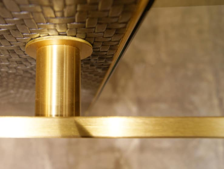 Embassy Suites Elevator Modernization wall panel face material is bonded pattern metal, bronze handrail and bracket
