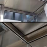 Close up photo of a section of the glass elevators at MSP Airport: lower inset drop ceiling with diffused lighting, inconspicuous exit, and glass seams. MSP MAC Lindbergh terminal LT-EL 20 by G&R Custom Elevator Cabs.