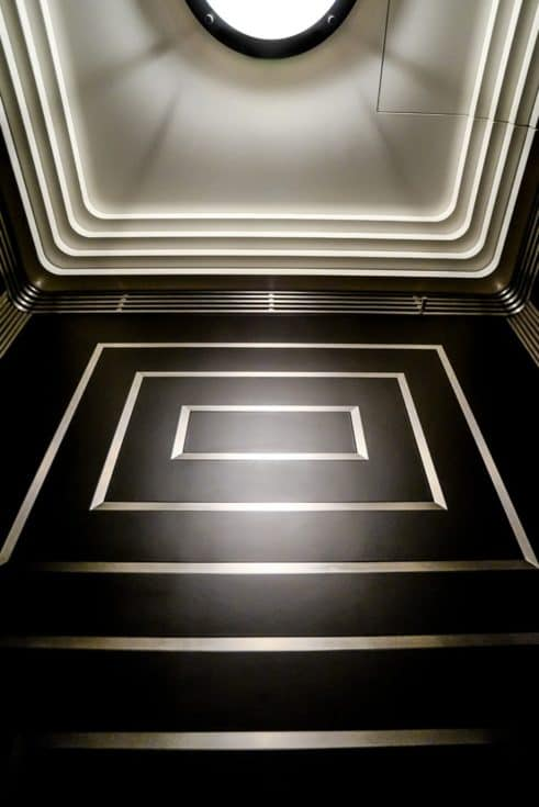 Partner: Urban Elevator Service, Inc. Materials: Black Powder Coated Steel, Stainless Steel #4 (satin), Inlaid Trim Design Elements: Art Deco