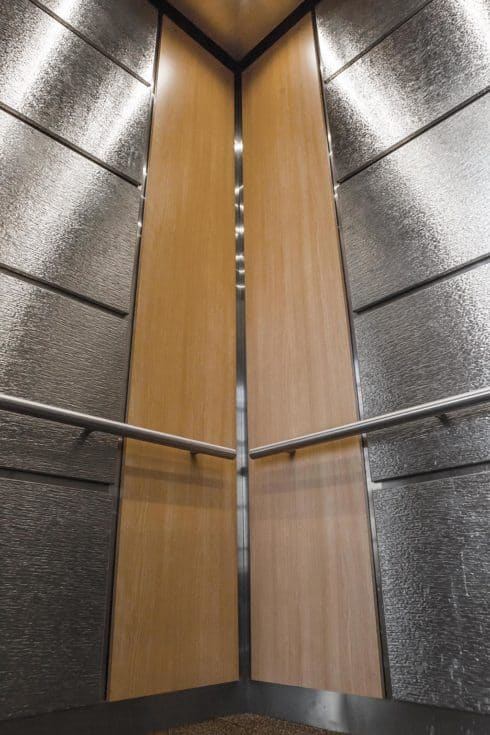#Elevator Wall Panels edge protection is bolstered with wrapped stainless steel in this high-traffic elevator at the Hennepin County Health Services Building, Minneapolis - manufactured by GandRCustomCabs.com (elevator interior design GR703)