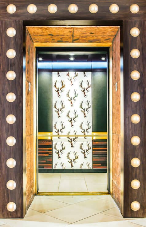 A photo of the custom elevator cab interior at the DoubleTree Hotel, Austin, TX. The elevator interior design transformation was completed during an equipment modernization that followed a robust construction timeline.