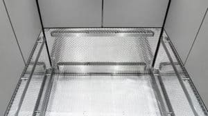 The lower horizontal wall panels are faxed with Aluminum Diamond plate (also known as Checker-plate)—a material that performs well in environments like this.