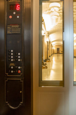 Vintage-looking accoutrements include Medium Oxidized Bronze Stationary Returns, Extruded Handrails, and Operating Panel Cover Plates. Other elevators involved in the project share the same design motif (Governor's Car & Service Car).