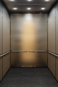 A photo of the custom elevator interior and lower ceiling. The elevators were recently modernized at 365 Nicollet located in Minneapolis.