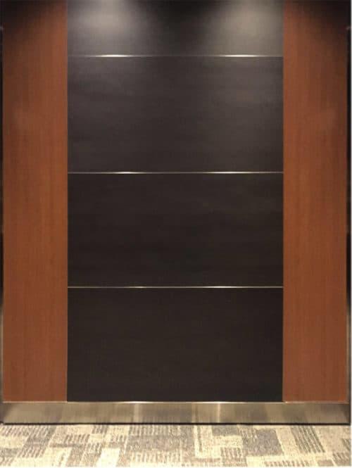 Elevator Modernization at 12701 Whitewater, Minnetonka. Laminate vertical accent panels and black horizontal center panels